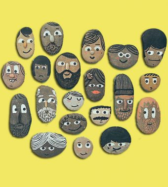 Pebbles with people's faces of all ages, gender and race.