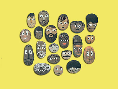 pebbles with different faces on